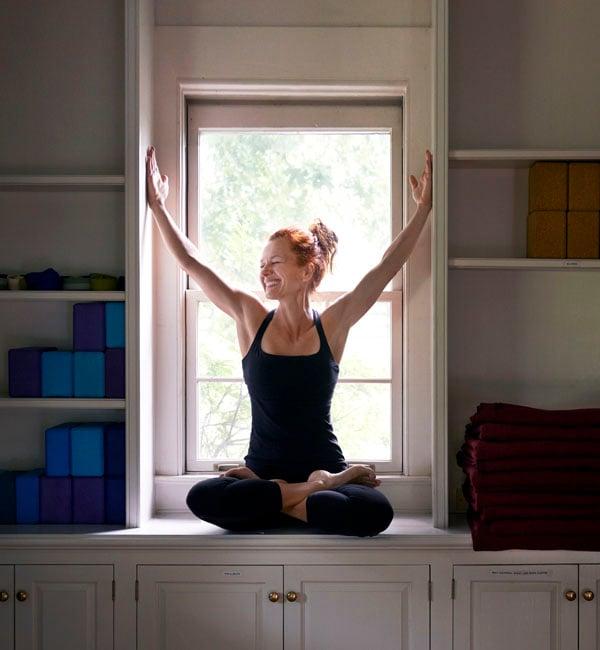 Sylvia yoga pose in window