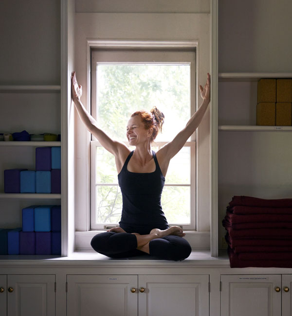 Sylvia yoga pose in window